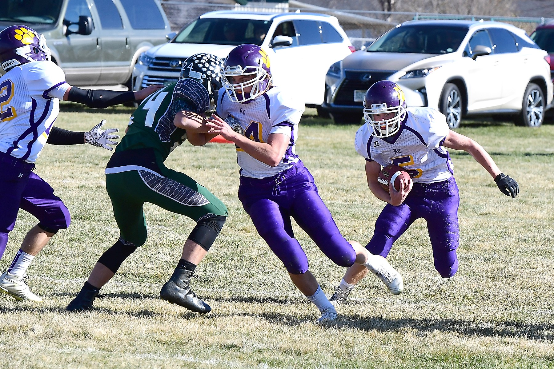 Kit Carson Wildcat Joe Bryan (5) carries the ball behind the blocking of teammate TJ Conway (14) in the 6-Man football quarterfinal game. Both players were named First Team All-Conference.