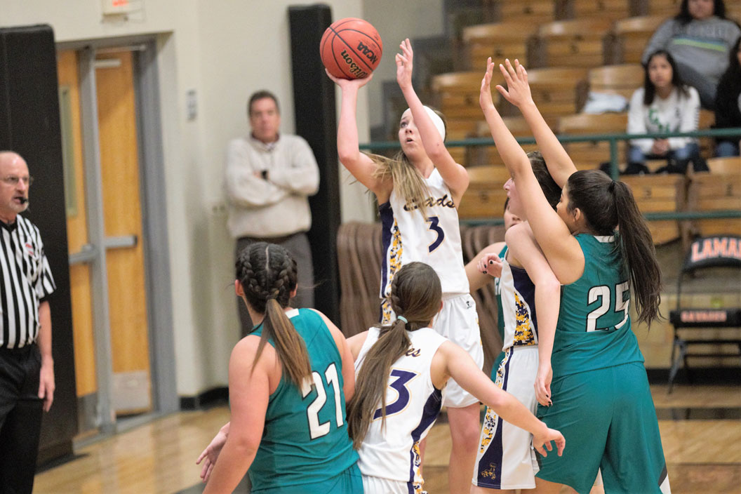 Eads junior Kaylee Wilson hits a jumper in District 2 quarterfinal action against Granada.  (Photo credit: Holly Mitchek)