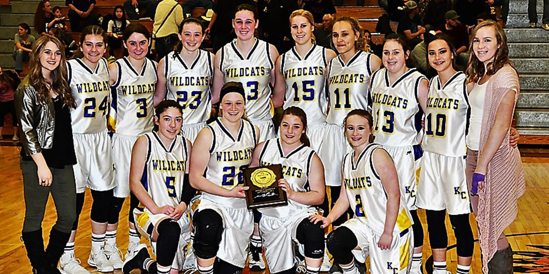 Kit Carson Lady Wildcats are the 2018 District 2 Champions (front) Allison Gekeler, Micayla Isenbart, Paige Johnson, Tieler Randel (back) Faith Johnson, Cally Booker-Rady, Haley Johnson, Reyna Isenbart, Olivia Isenbart, Tess Hornung, McKenzie Smith, Jordyn Weeks, Mercede Smith, Janae Voss (Photo Credit Bob Schecter)