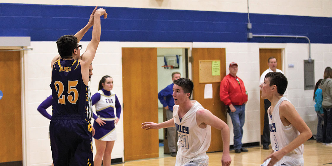 Blake Stoker shooting a three during the Eads vs. Wiley game - Photo Credit Holly Mitchek