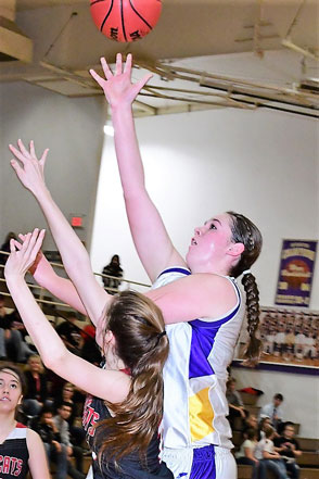 Olivia Isenbart puts ball up against Holly defenders - Photo Credit Bob Schecter