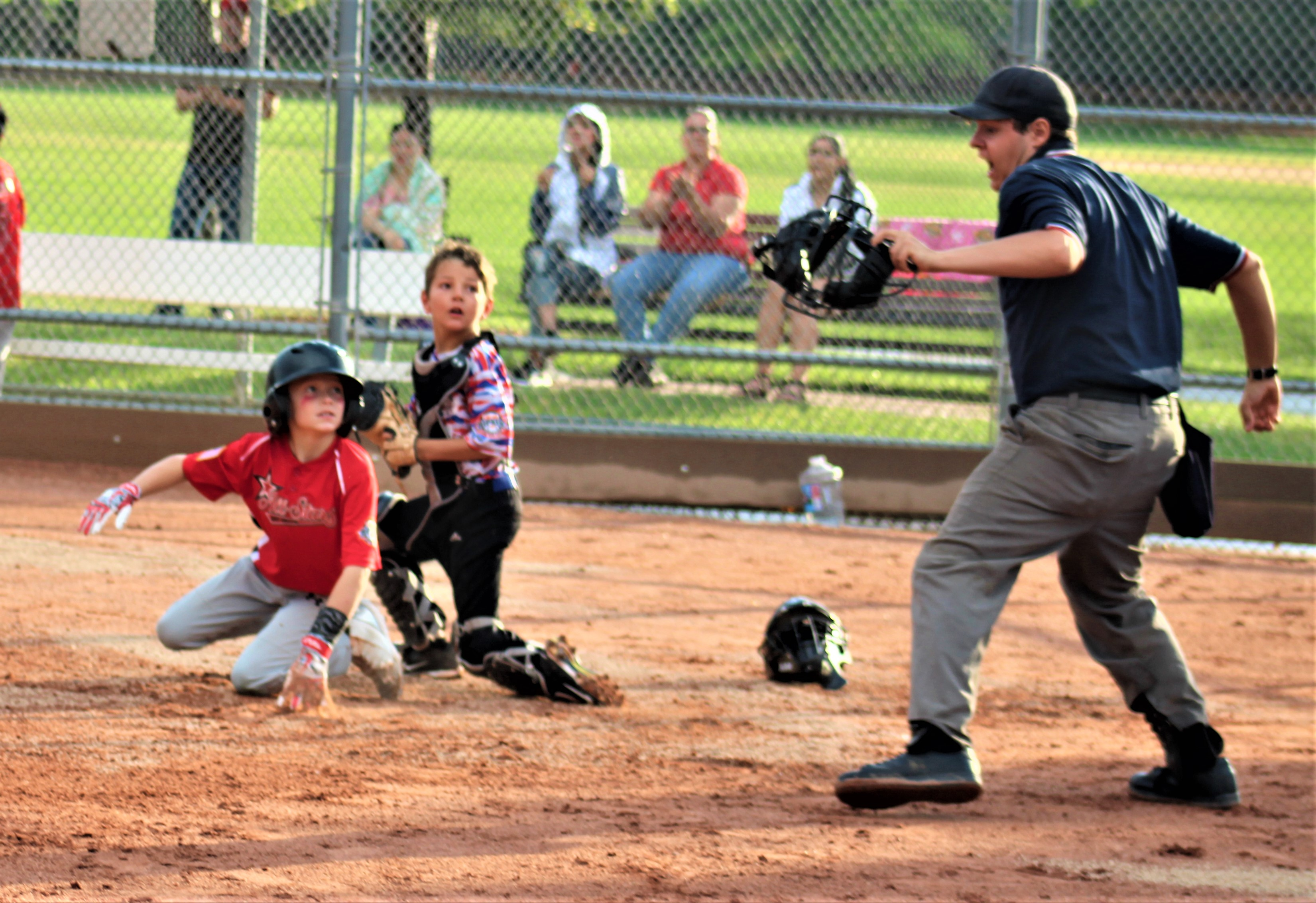 Opponent and Ayden waiting for the umps final call at the plate---he was called out! (Photo credit: Rachel Bletzacker)