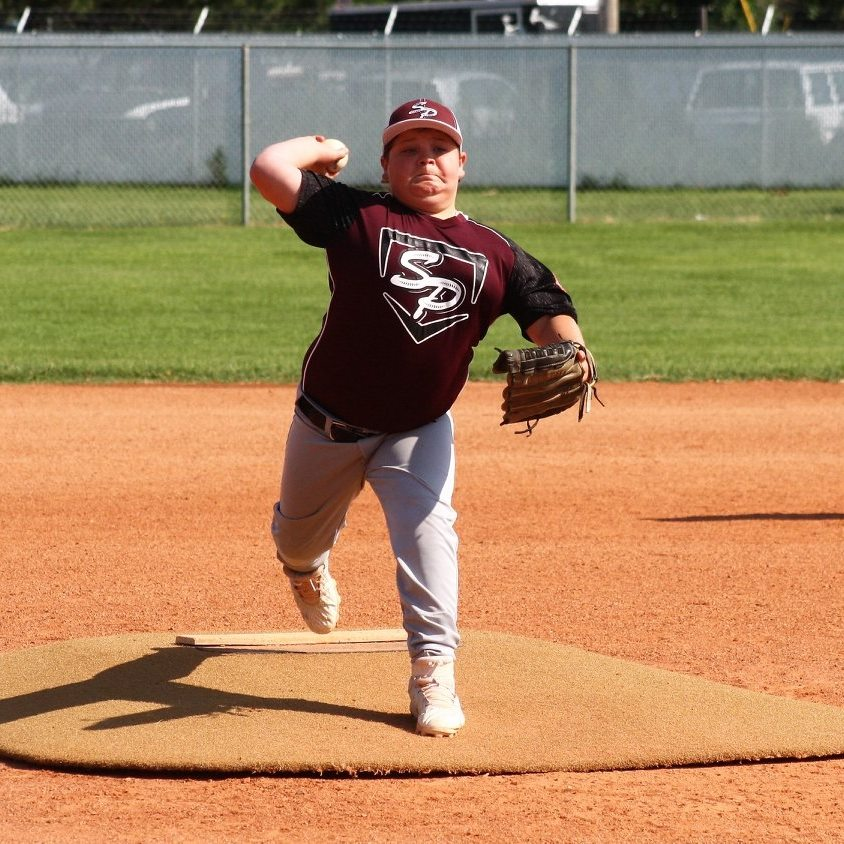 Spencer Uhland throwing off the mound in the 11U 70s Colorado State Baseball Tournament in Southeast Denver. (Photo credit: Monica Uhland)