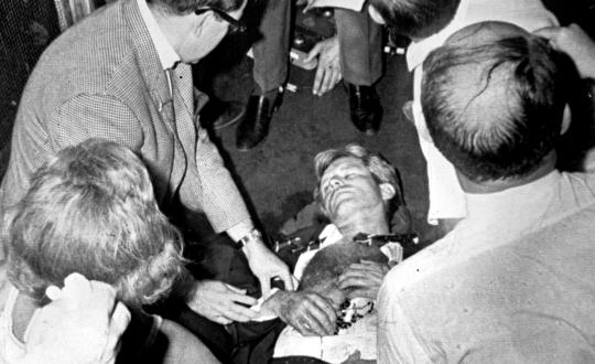 RFK on floor after being shot.  Rosary beads had been placed under his hand. Wife Ethel is in lower left hand corner