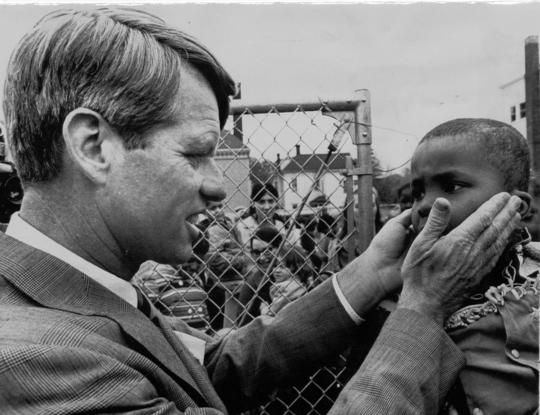 Robert Kennedy pats face of child at day care center in Oregon