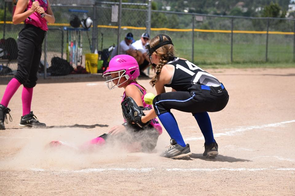 Bailey Sierra slides in safe at home during 10U state softball action in Elizabeth over the weekend. (Photo credit: Jessica Sierra)