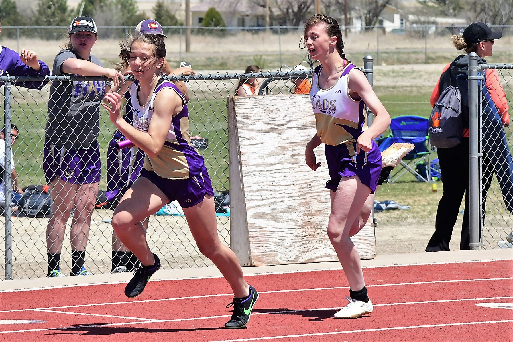 4x200 girls relay with Reagen Johnson handing off to Ally Spady.  Eads placed in 1:54.67 (Photo credit: Bob Schecter)