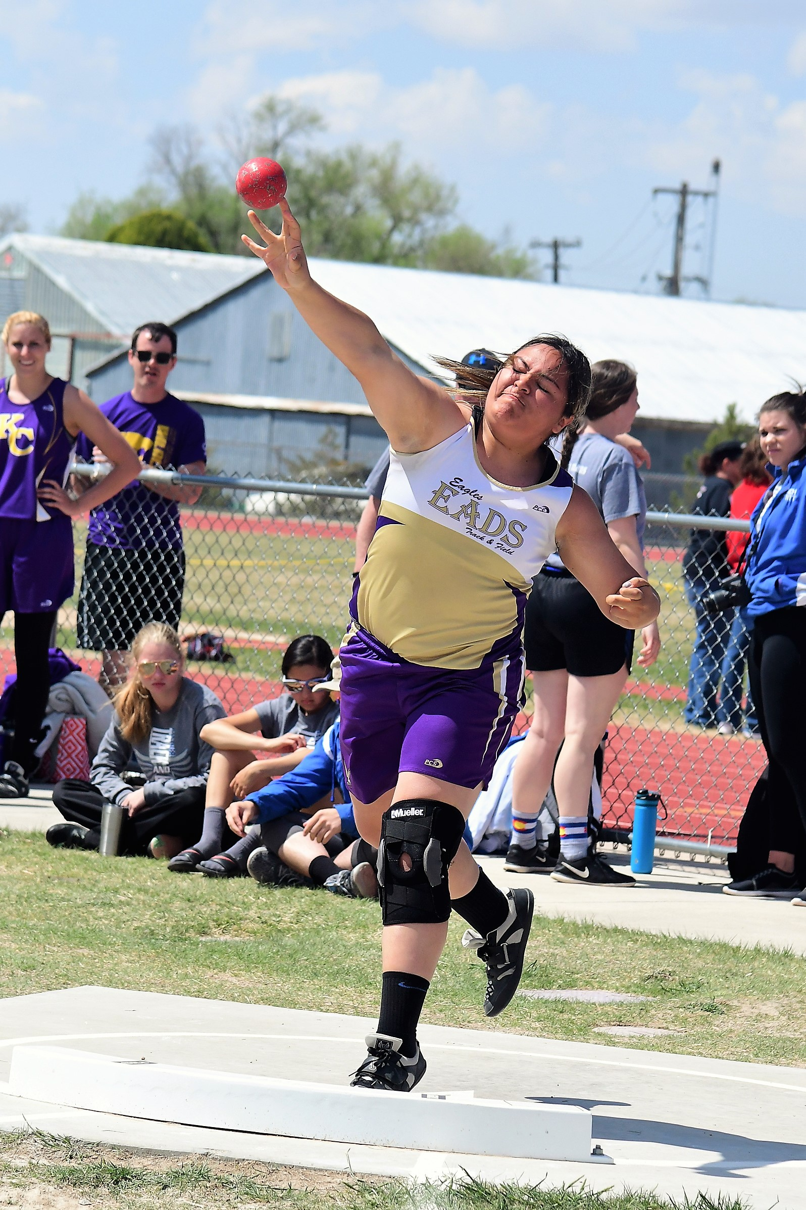 Eads Colby Stoker sends her best shot put toss of the season off in Limon.  The freshman battled through injury and finally came back into form just in time to qualify for state.  (Photo credit: Bob Schecter)