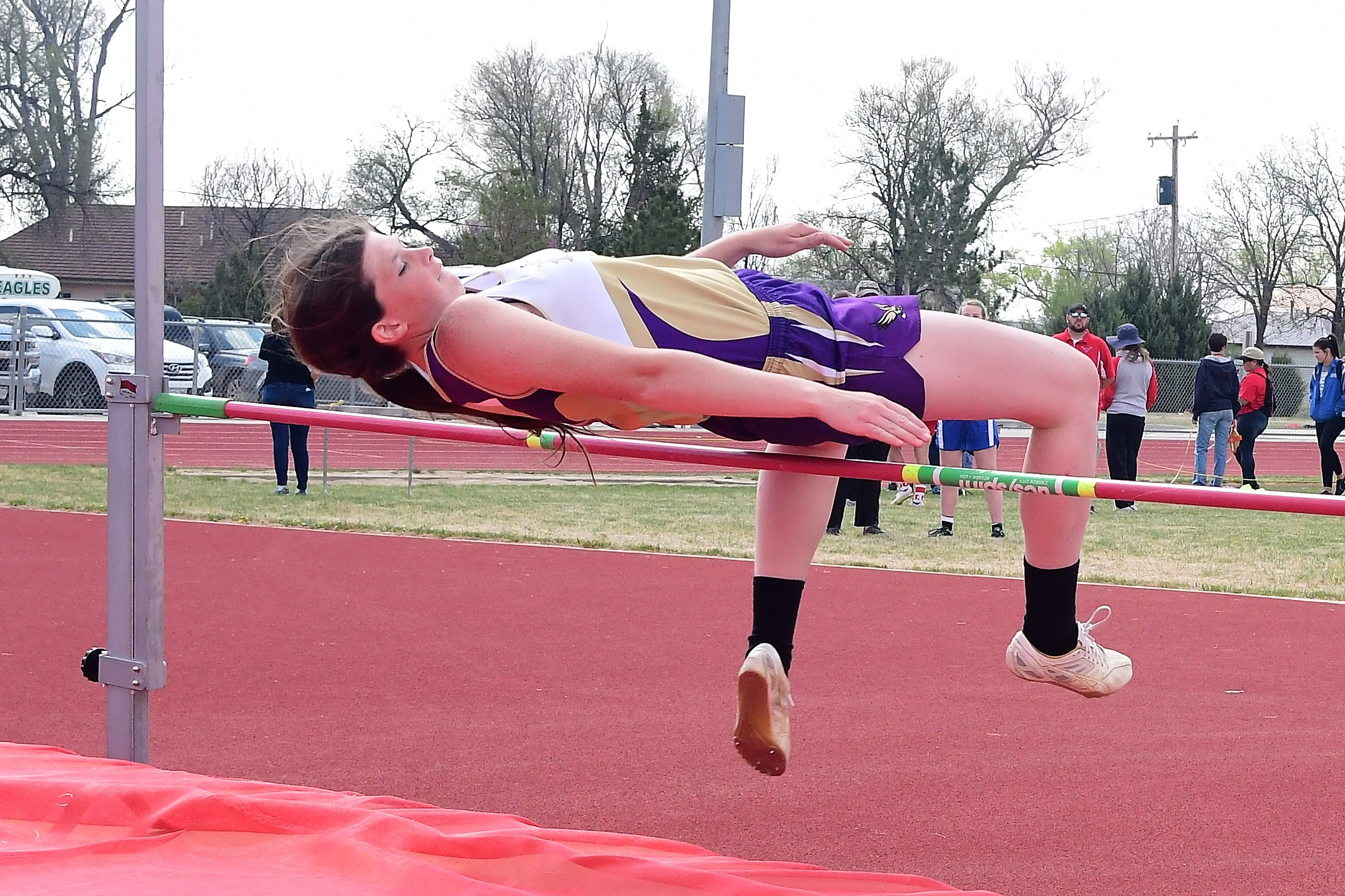 "Morgyn Johnson gets over the high jump bar at 4' 7"" at Holly (Photo credit: Bob Schecter)"