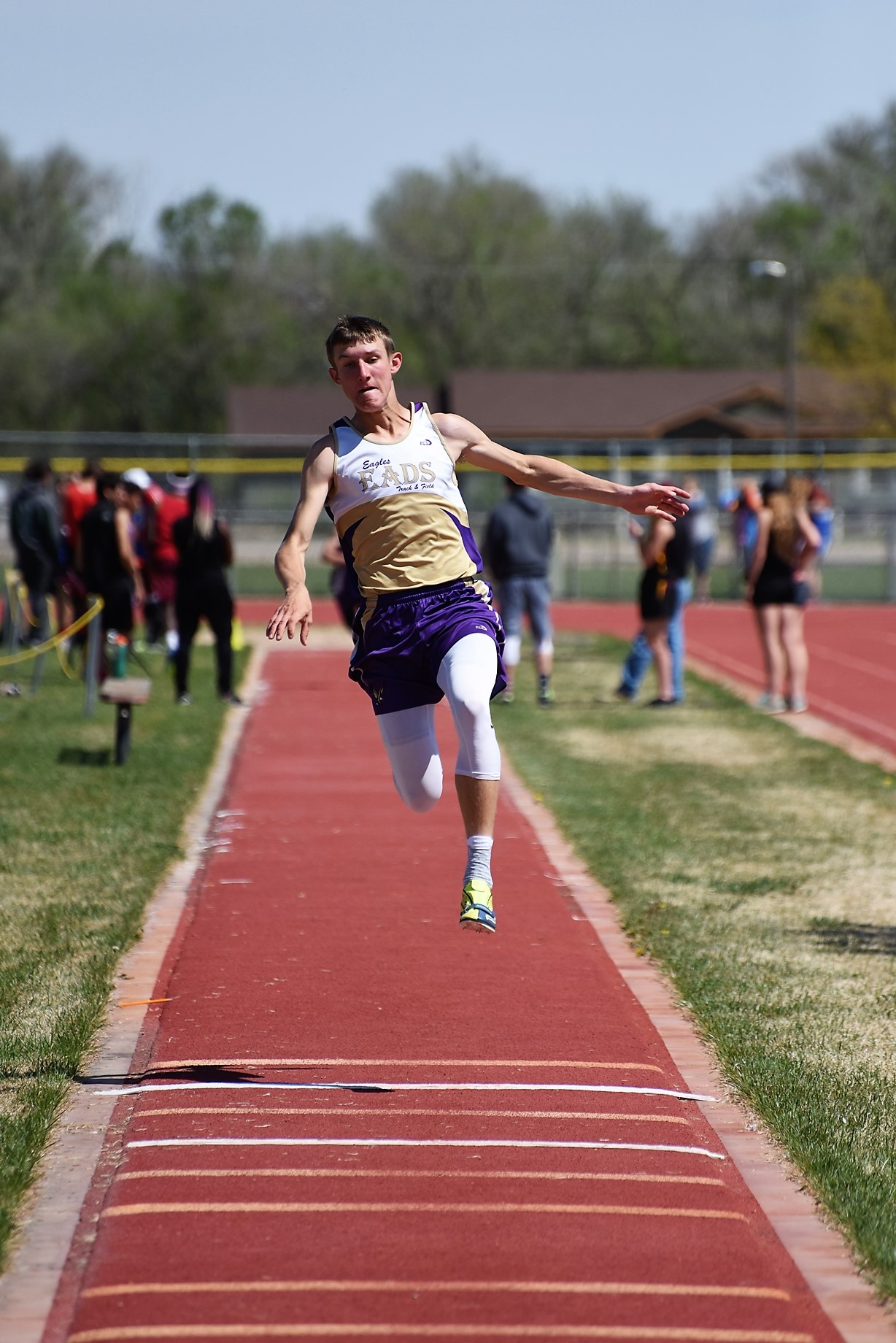 "Zach Haase broke the Eads school record in the triple jump for the second week in a row with a 43' 8"" leap in Holly.  (Photo credit: WildcatPridePhoto.com)"