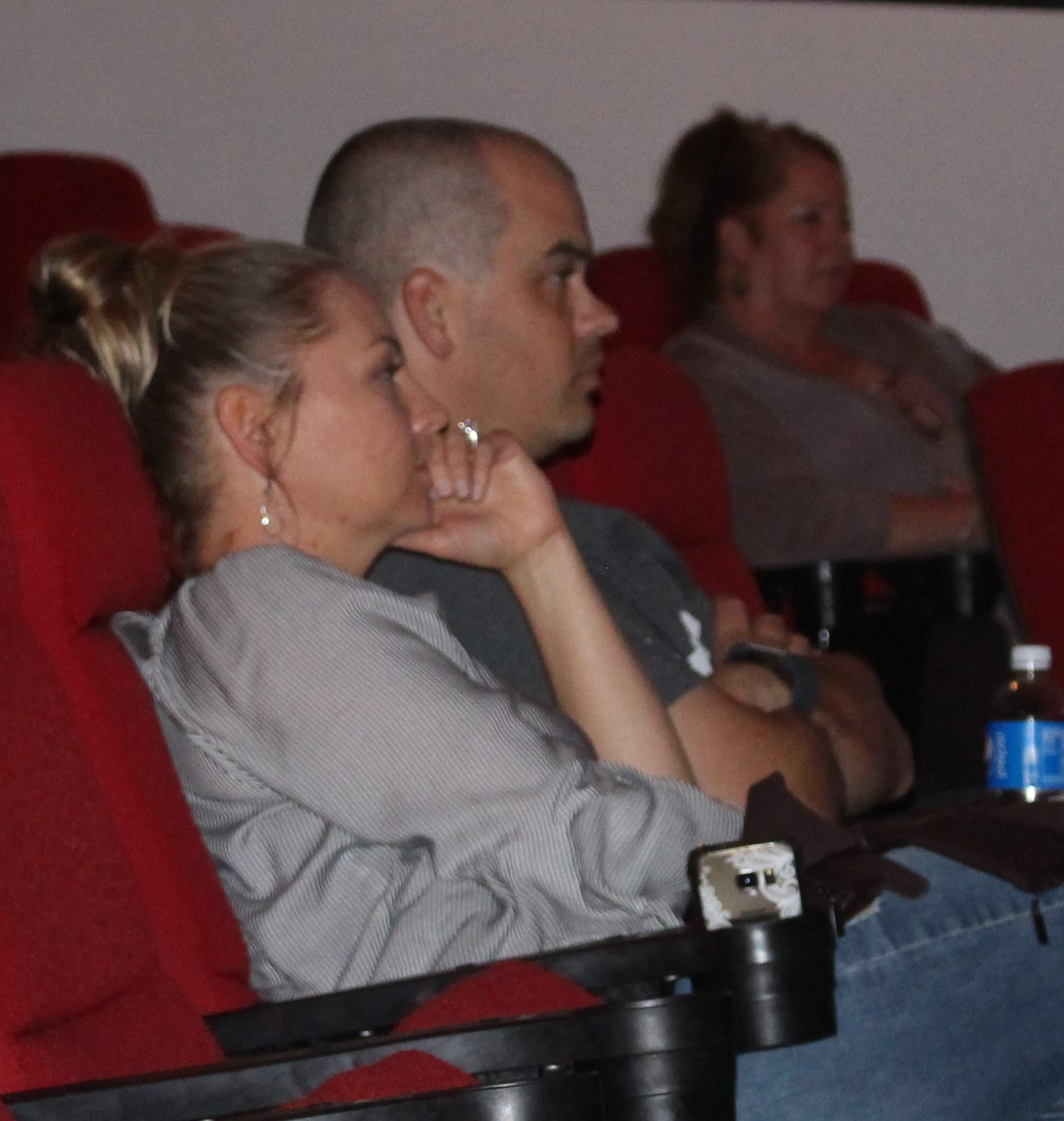 Kelly and Preston Courkamp watching the Kiowa County Candidate Forum