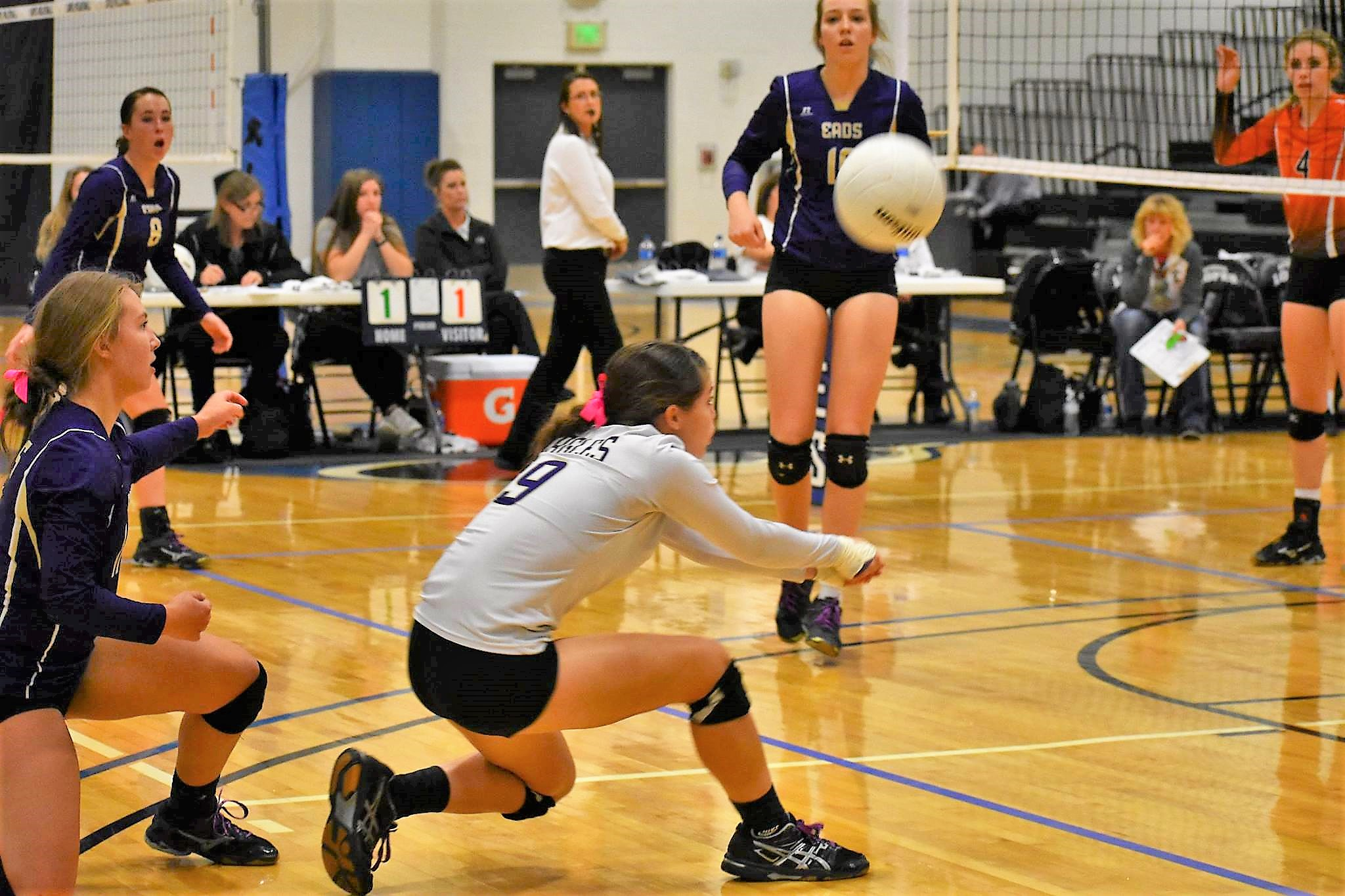 Hadlie Rittgers digs for a ball during District 2 Action - Photo Credit Wilson Photography