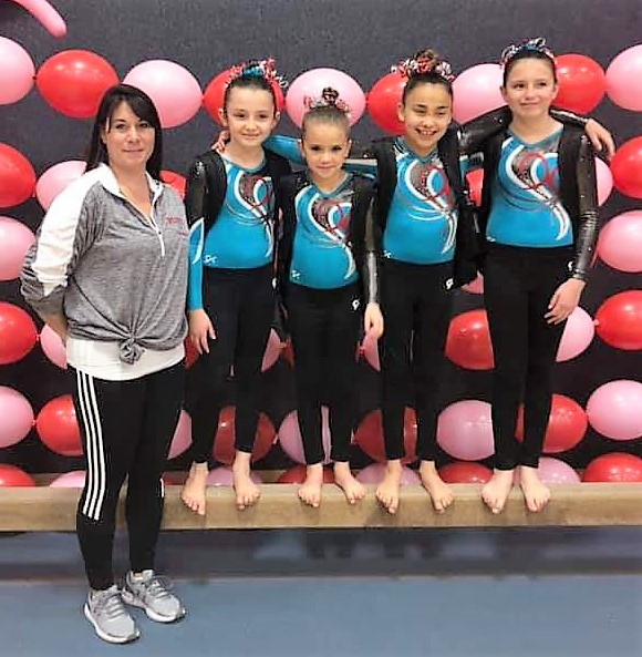 Head Coach Joette DuVall pictured with Level 1 gymnasts Abygail Stevens, Brystal Bletzacker, Layla Garcia and Kali Stevens - Photo Credit Rachel Bletzacker