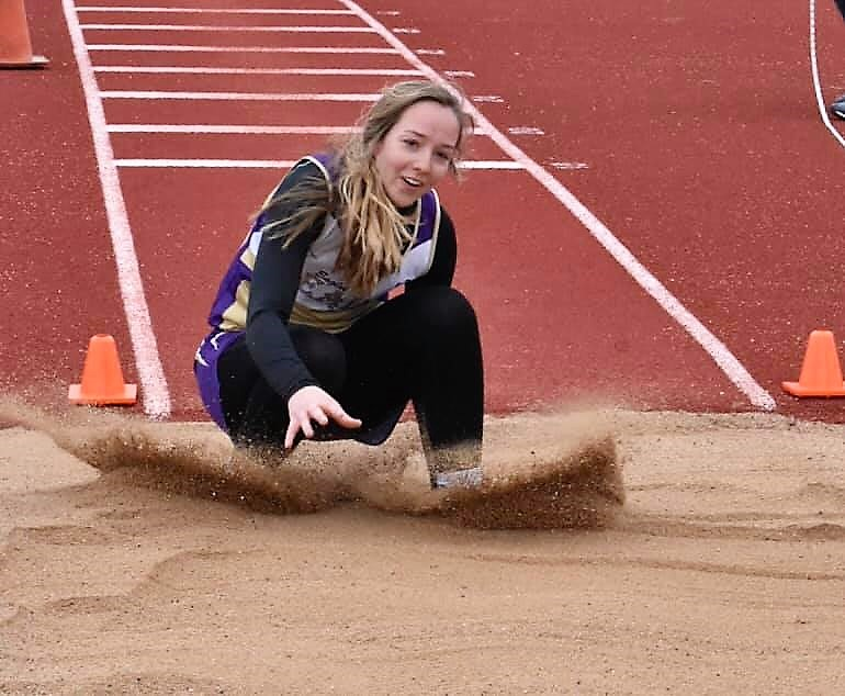 Senior Kaylee Wilson controlled the jumping events at the La Junta Tiger Relays on Friday as she won the Long Jump and Triple Jump events. - Wilson Photography