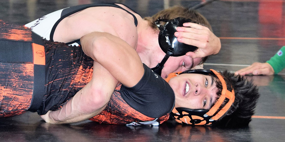 Aiden Michael gets a first place finish with his pin over Zeke Buker from Kiowa during the Kiowa Tournament