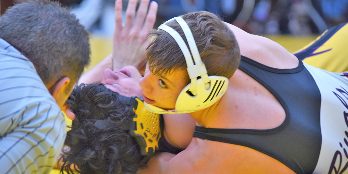 Tate Krentz working on the pin against Marcus Montes from Dumas. - Photo Credit Rhonda Uhland