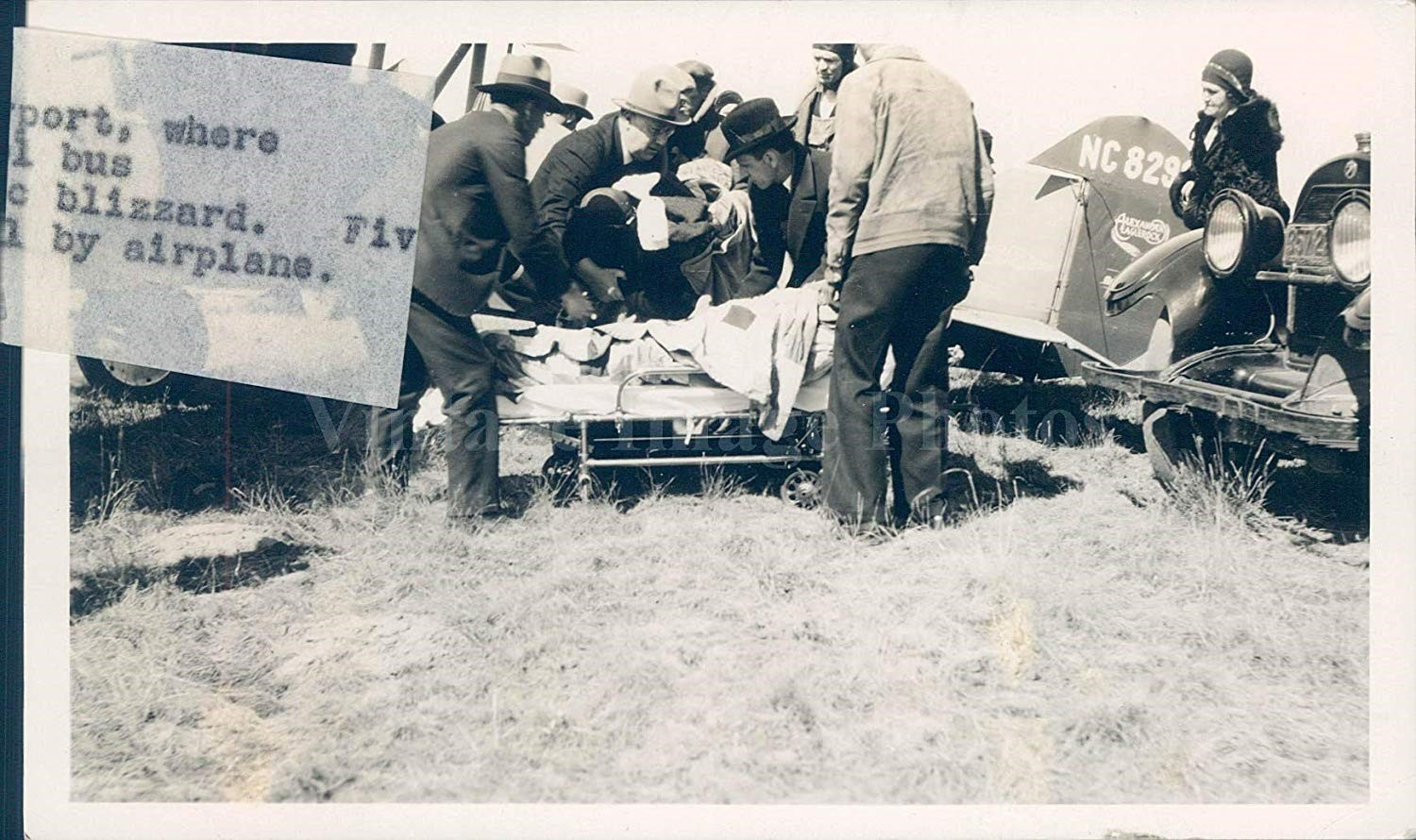 Press photo of children being flown to the hospital by local pilot