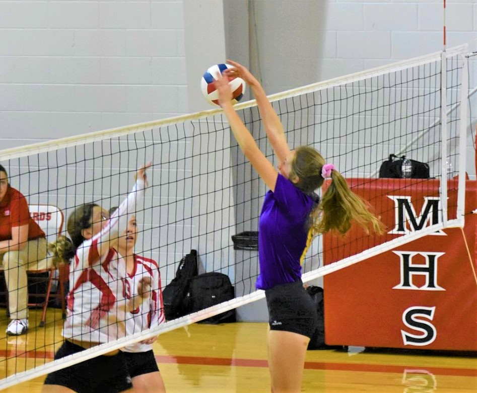 Eads freshman Maggie Haase blocks a McClave kill shot during District 2 action in McClave on Tuesday.