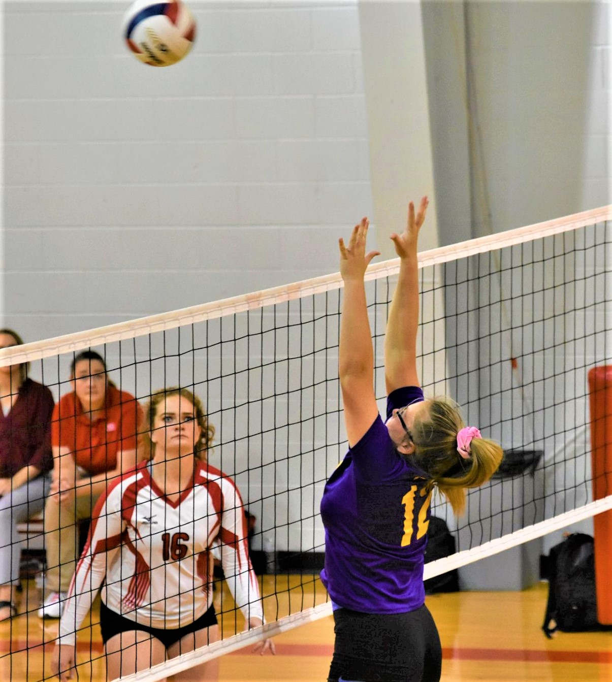 Kyra Sheridan goes up for a block during Eads vs McClave volleyball action.  Eads won 3-1 to secure the runner-up seed in the upcoming District tournament.