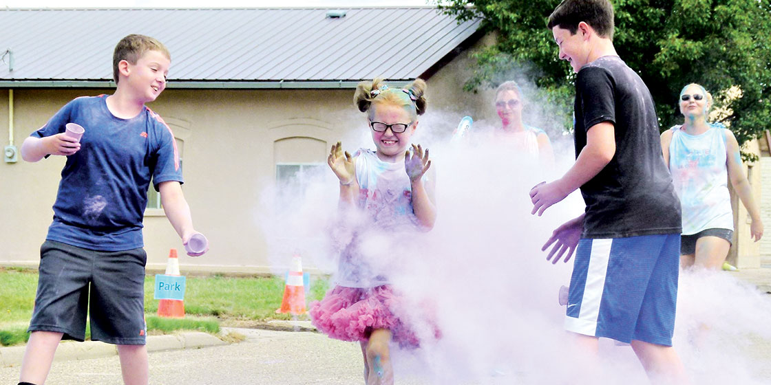 Hatch and Case Nelson helping with the color run - Contestant: Addison Courkamp