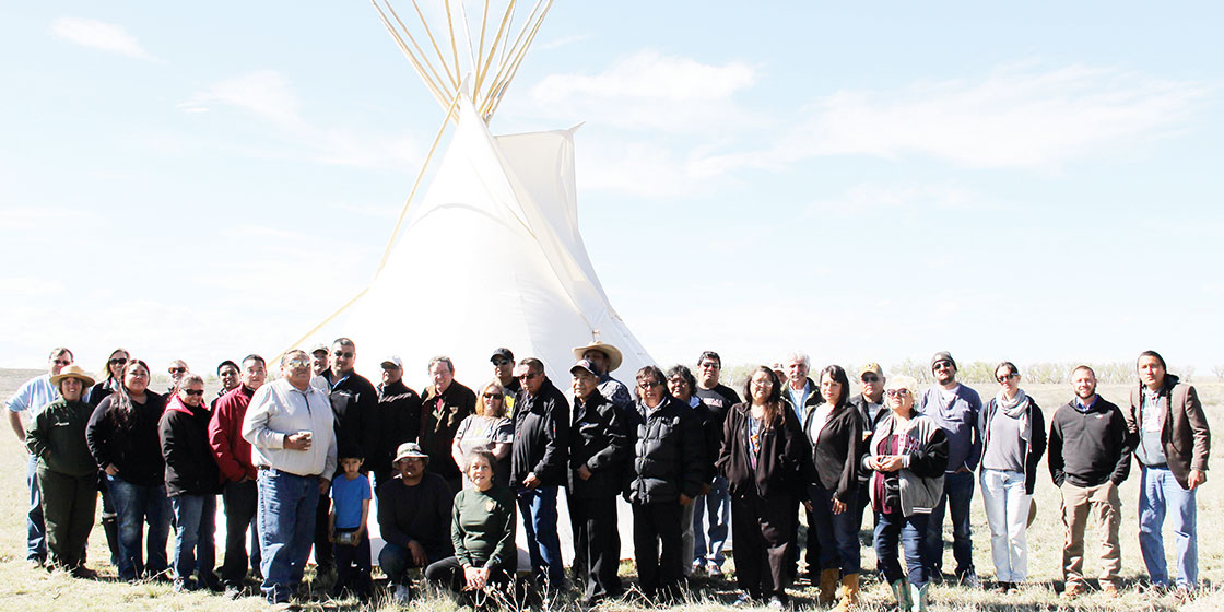 On grounds of Sand Creek Massacre NHS for group photo of participants in the tribal consultation during the 10th anniversary