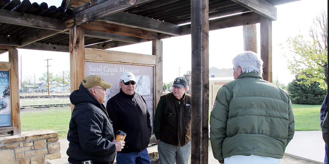 At roadside park in Eads where tour begins for Sand Creek Massacre. Karl Zimmermann, Chief of Operations and Facilities at Sand Creek Massacre NHS, with his back to the camera. L to R:  Herbert Welsh, Northern Arapaho; Otto Braided Hair, Northern Cheyenne; Dr. David Halaas, Author, former Colorado State Historian & Northern Cheyenne consultant.