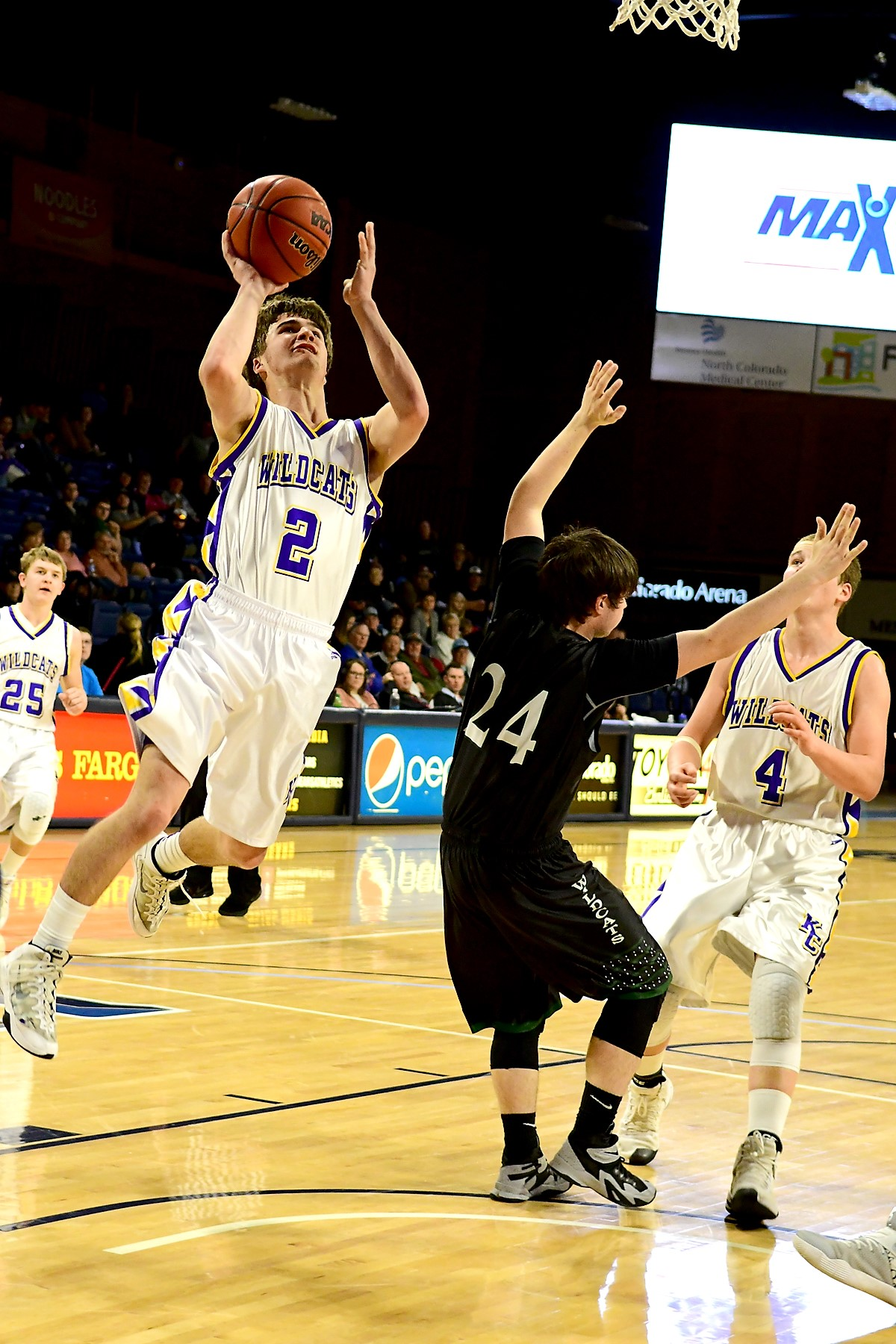 Kit Carson - Brad Johnson going up for a layup during the 3rd Place State Tournament - Photo credit Bob Schecter